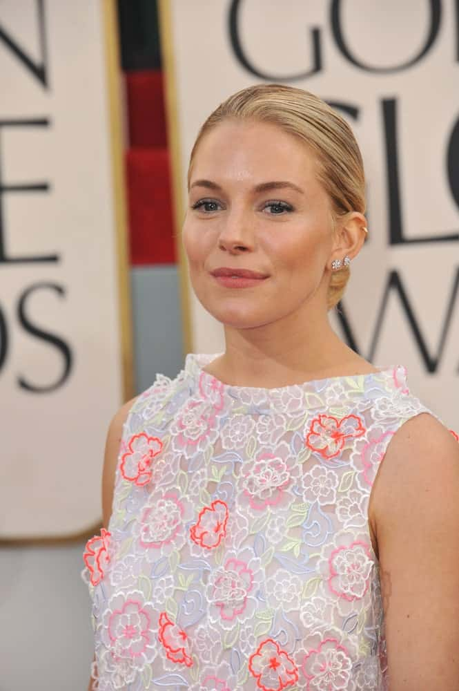 Sienna Miller showcases a sweet aura in a floral dress and neat, low bun hairstyle at the 70th Golden Globe Awards on January 13, 2013.