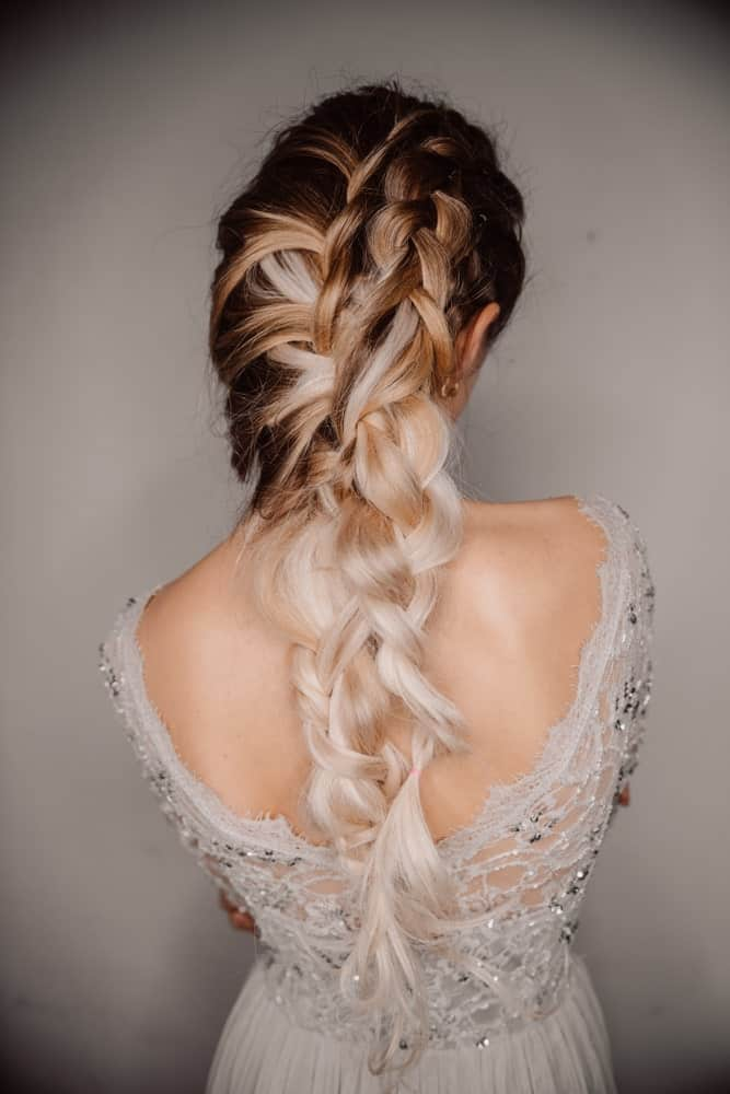 This is a beautiful hairstyle for prom. With interwoven, intricate braids it's beautifully alluring while still being soft and not too sleek so it looks incredibly feminine.