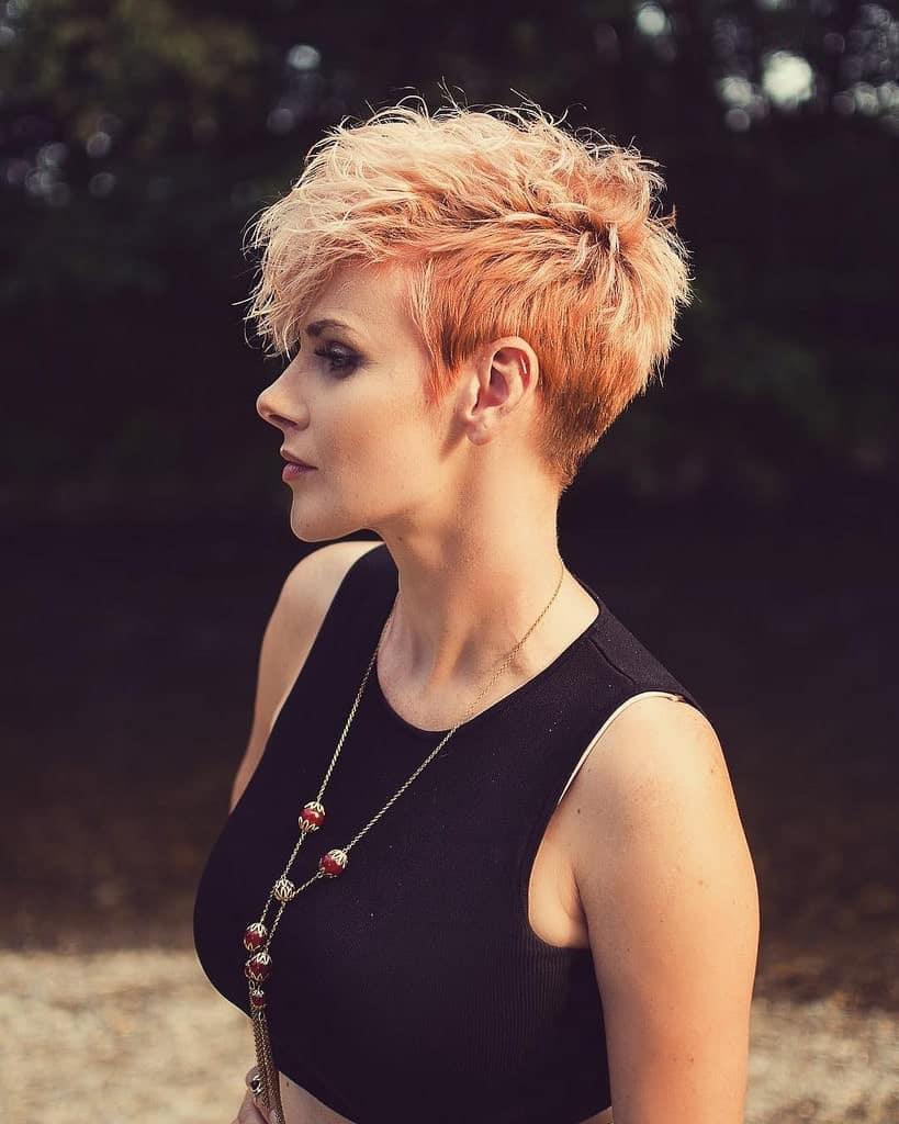 Unlike the super-straight classic pixie cut style, the feather pixie cut has the added benefit of giving your hair a bit of volume because of its feathery, fluffy texture. This one perfectly highlights this young woman's cheek and jawbones.