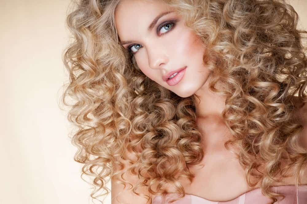 Do you have thin hair and don't know how to style it? Give yourself a heedful of corkscrew curls. The small and tight curls will give you hair volume, making it look bigger and more dramatic.