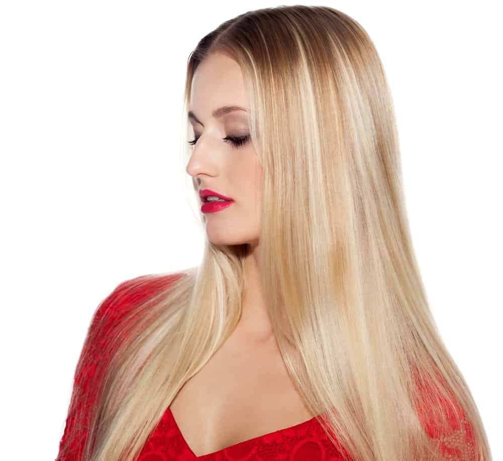 Take a look at this model who is sporting a balayage of multiple shades of pale silver and blond. The various hues of color give her hair an added dimension and make it look more voluminous.