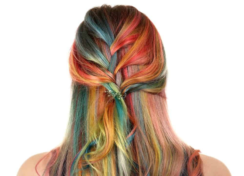 Soft waterfall braids at the back of the head are a great way to showoff colorfully dyed hair like we can see here.