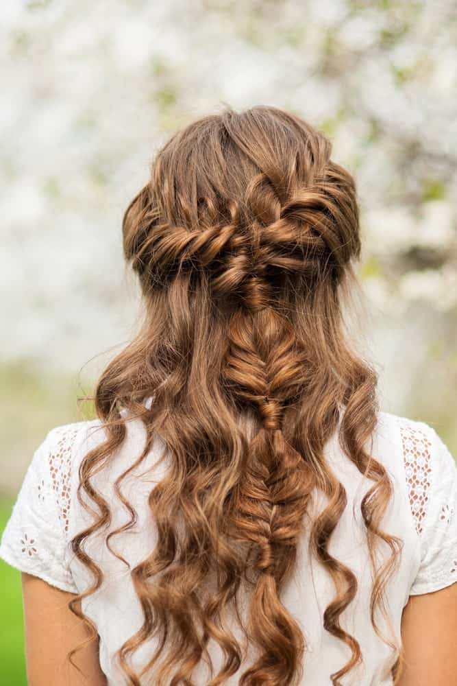 This waterfall braid continues down the back of the head, giving a unique finish among a bed of curls. Definitely something to add a little oomph factor to your hairstyle.