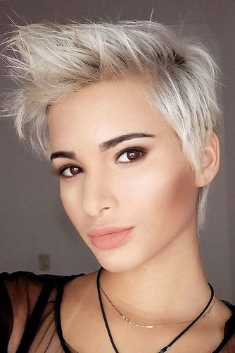 Want to get that punky, rockstar look. This pixie haircut is the perfect style for you with its pale silver strands and long, sharp frosted spikes in the front.