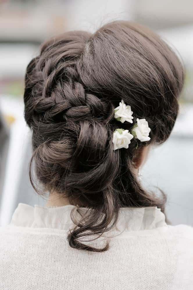 Combining a flowing braid, soft curling locks and a backcombed crown gives a beautiful result!