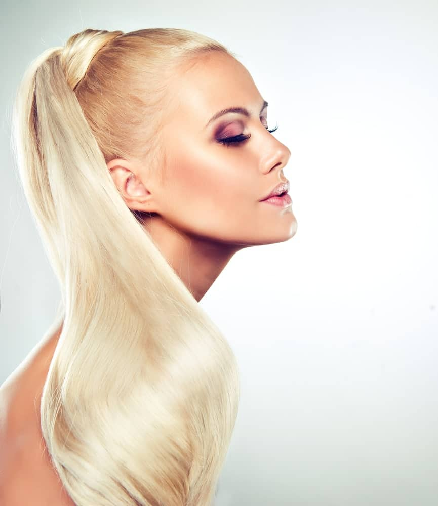 If you want to showcase you straight, sleek and long hair, rocking a genie ponytail should be high on your list. This ponytail is tied up high on the head, usually on the crown. This gives the illusion of longer hair. It also gives a beautiful cascading effect to the hair.