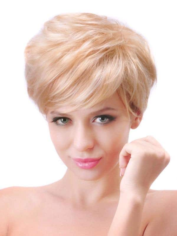This particular pixie hairstyle has not cut down on the thickness of the hair, only its length. If you want to get that 1960s actress look, with a full crown of hair, only shorter, this is the haircut for you