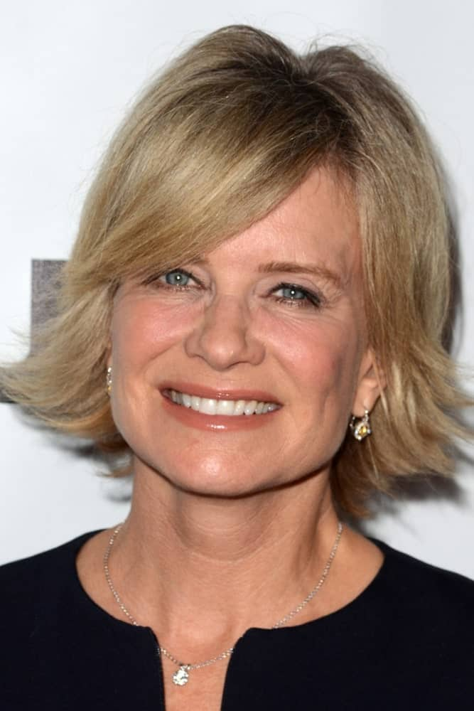Mary Beth Evans is sporting a haircut that can look marvelous on women over 60. An outward layered bob with side bangs is all you need to add volume to your hair and give them a boost of liveliness.