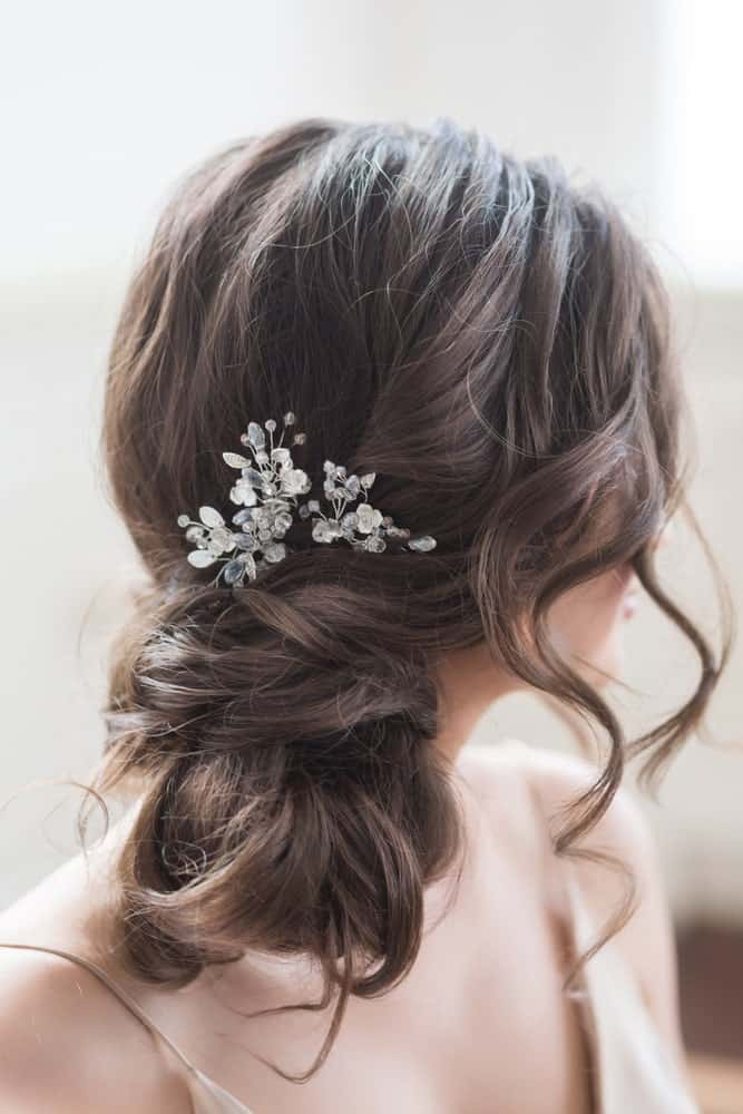 A modern, easy side bun with flowers and curly strands around the face make for a gorgeous hairstyle to go with all types of dresses!