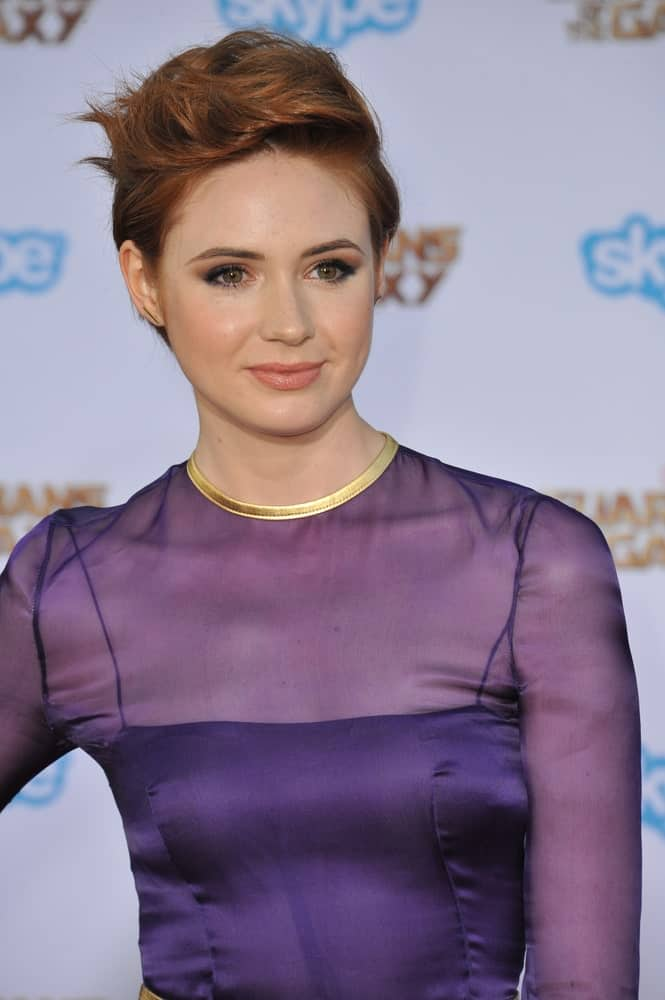 Karen Gillian's hair is naturally a gorgeous shade of copper. She styles it here with a trendy short updo that adds waves to the top of her head while keeping the sides sleek and straight.