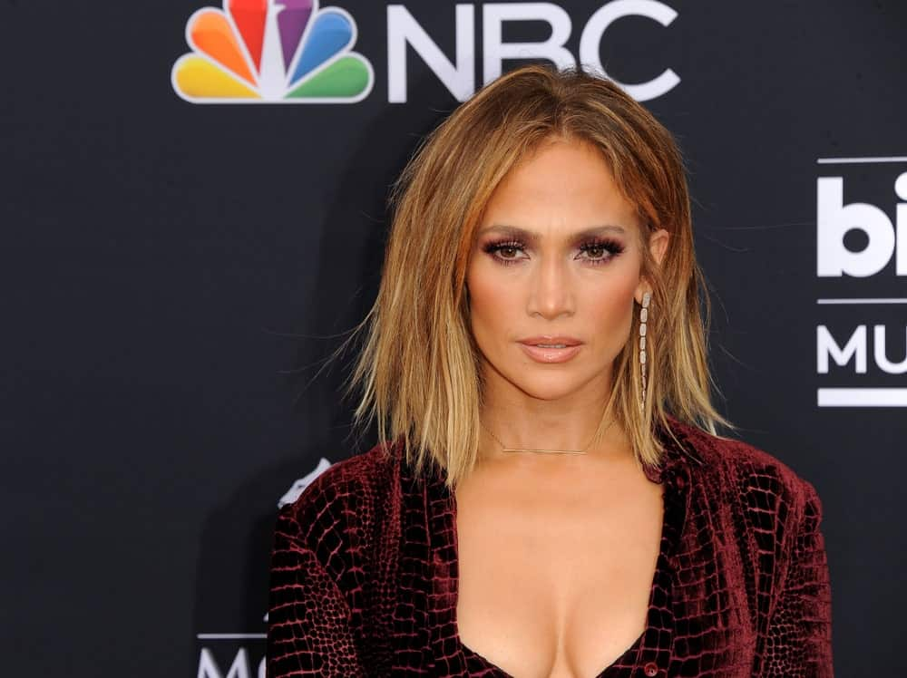 Is there any style that Jennifer Lopez can't do justice? The ever-youthful singer gave her hair a lot of dark gold ombre. She then styled the look with a straight and jagged haircut giving her an edgy look.