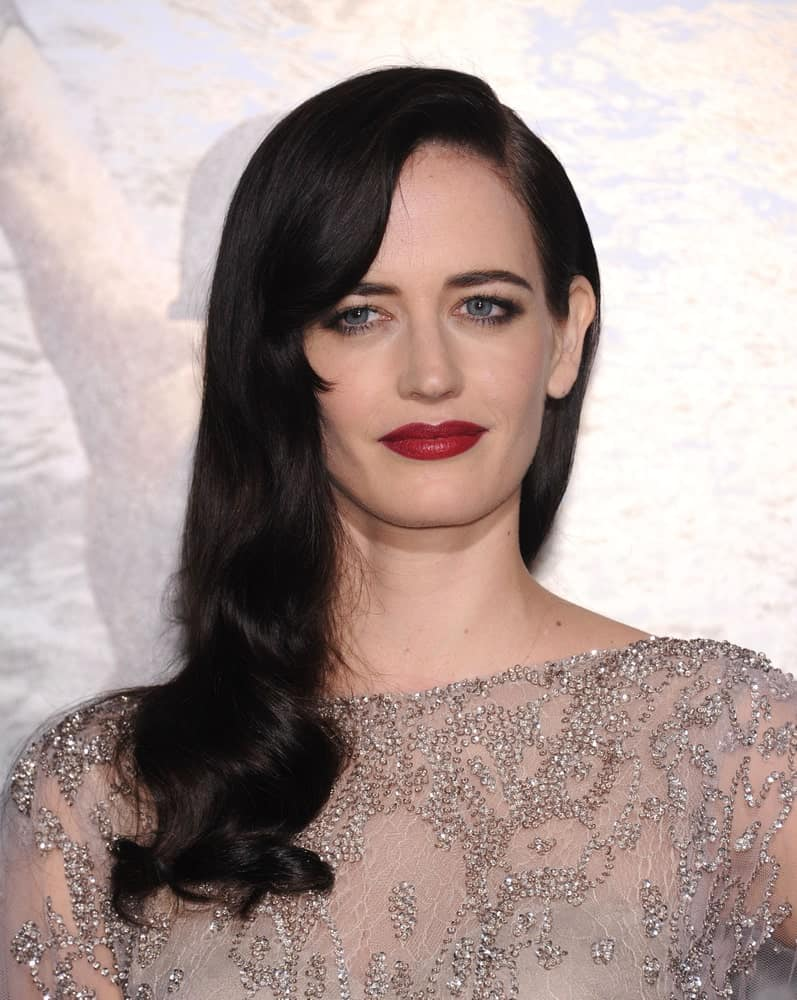 This stunning actress is not your average French woman. When it comes to her hair, Eva Green has nailed every look. With her super dark hair, the actress rocked this 1920's loose curl hairstyle, which made her the belle of the ball.
