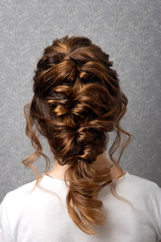 While a Greek braid may look too casual for prom, trust us when we say that you're going to look absolutely unforgettable. The braid adds volume and character while still being timeless.