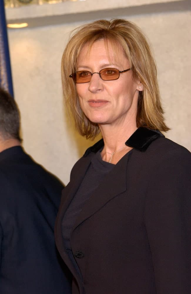 This is a simple, yet one of the most elegant hairstyles that work well for women over 50 and go beautifully with glasses. If you sporting a simple a bob cut, simply tuck the hair at the sides behind your ears and put on your glasses – you are good to go! However, keep in mind that an un-tucked Bob can also look quite impressive.