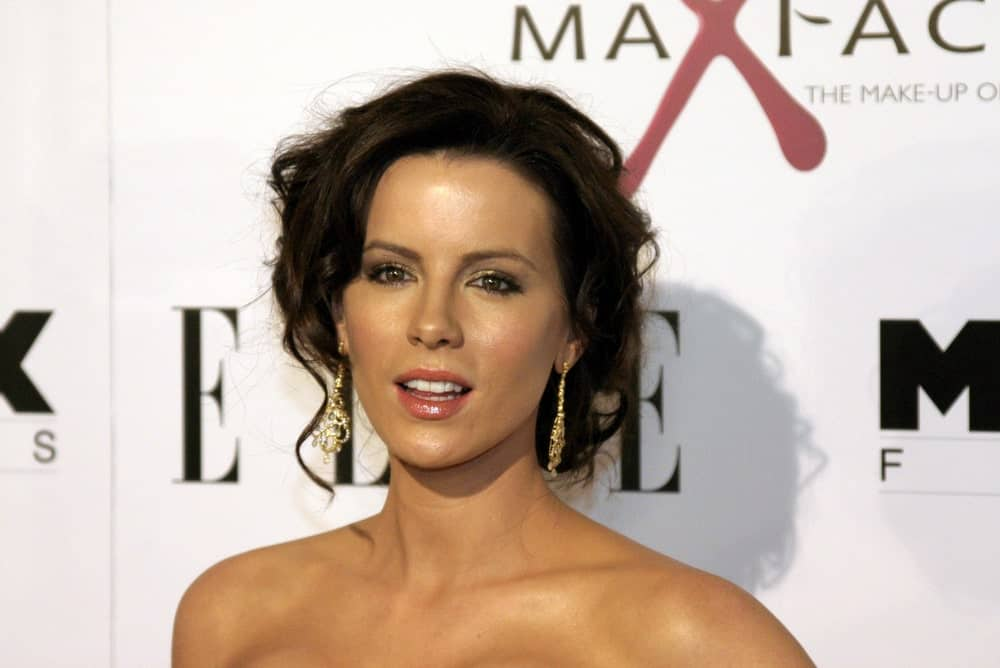 "When she is not rocking the cropped ""Underworld"" vampire look, Kate Beckinsale has pretty long hair, which she likes to style in elaborate ways. This super-messy and voluminous updo is perfect for a chic look. What's more, it's the perfect style if you are having a bad hair day."