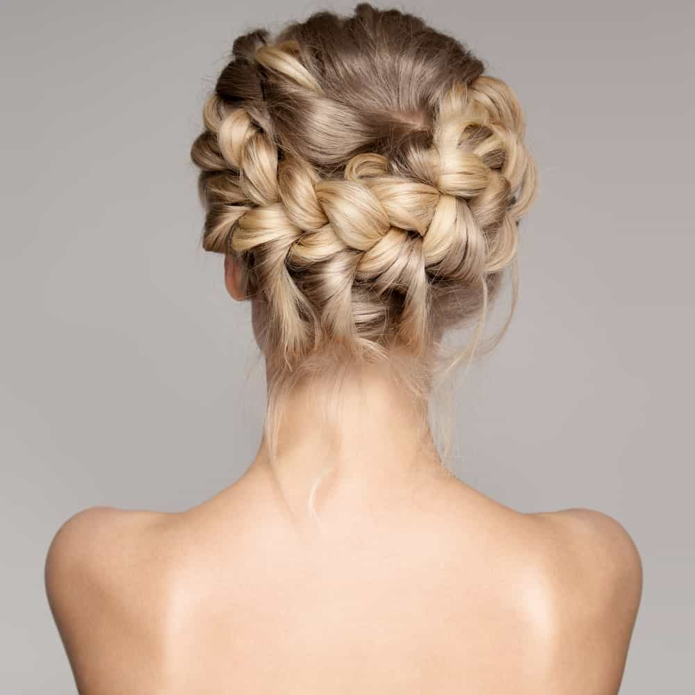 If you want something more polished for prom, why not go for this beautiful braided updo? It's neat, elegant, and a perfect complement to any dress.