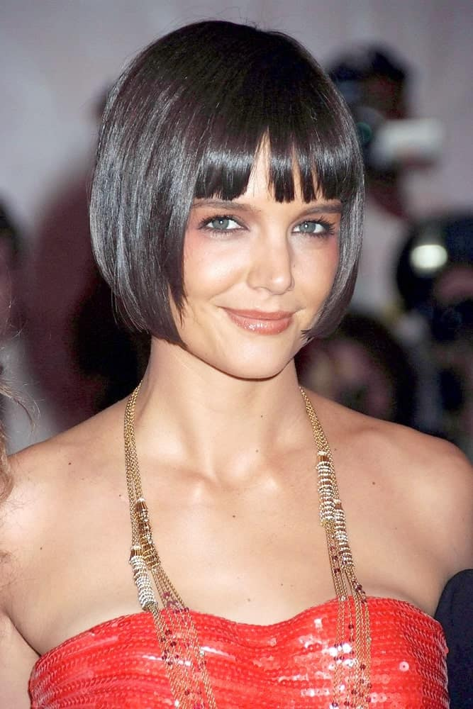 Her chin-length bob cut and a straight fringe gave Katie Holmes a fresh, new look. Make sure your hair is frizz free and glossy to pull off this wonderful hairstyle.
