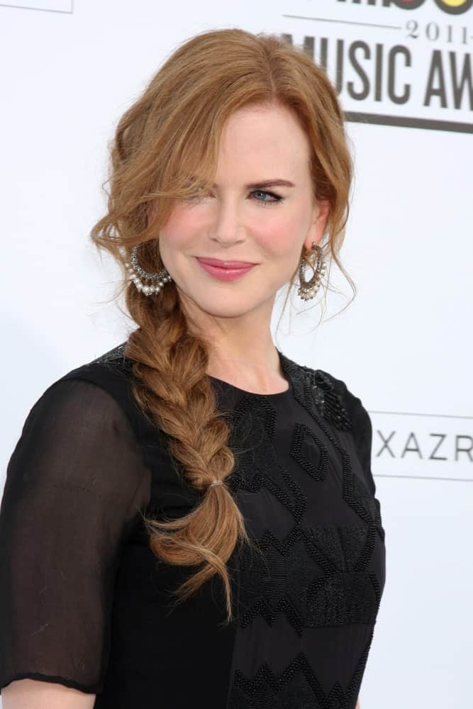 A loosely tied braid with some wavy face framing layers makes Nicole Kidman's light copper hair stand out even more and we're loving it!