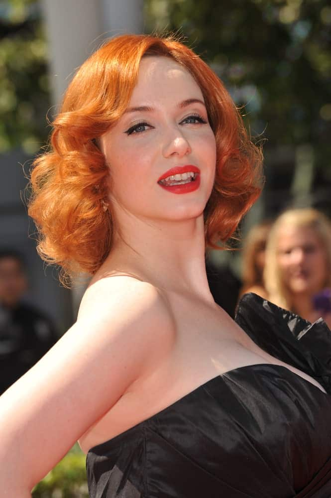 Hollywood curls look gorgeous on short hair too. They add a very Marilyn Monroe touch to your overall look. Pair them with some side swept bangs and you'll look every bit as glamorous as Christina Hendricks does here!