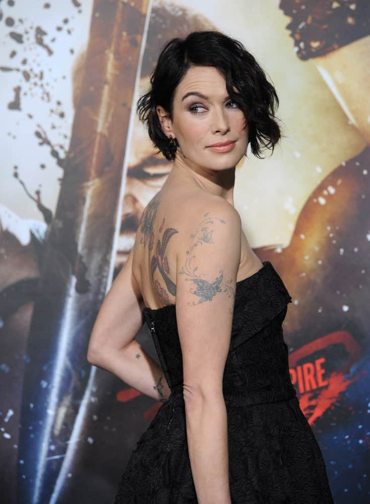 "When she isn't killing her opponents in ""Game of Thrones,"" Lena Headey is slaying her hairstyle look. The actress chose to style her choppy bobbed hair with windblown and messy locks. The look perfectly complemented her glittery gown."