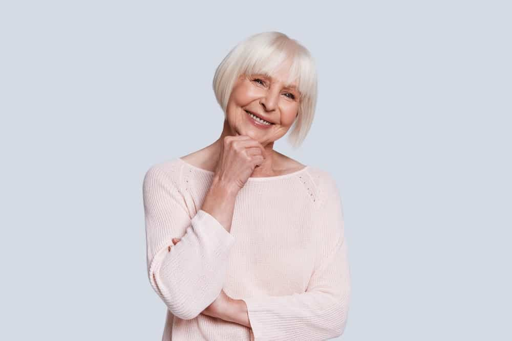 "Nothing says ""aging gracefully"" better than this sleek, straight angled blunt bob. Add in the fringe and it simply can't get any more stylish. In fact, it won't be wrong to say that this hairstyle ranks quite high on the chic scale for women over 60!"