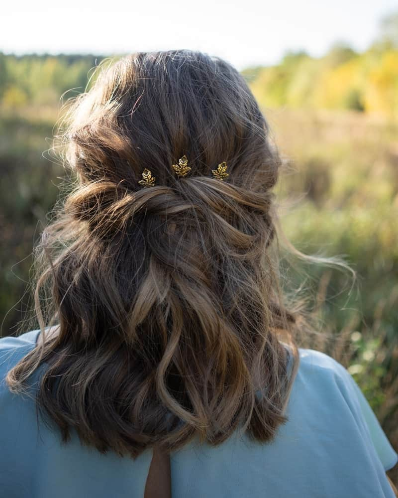 An easy hairstyle for any length of hair is a simple half twist. You can accessorize it for a fancier finish or leave it as it is for a nice, soft look.