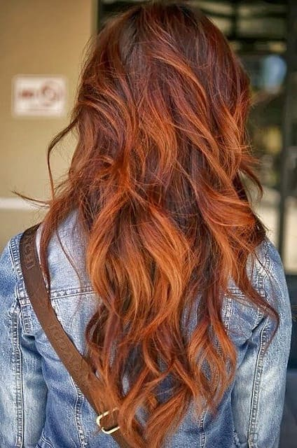 This gorgeous natural shade of red has been enhanced by some judicious balayage treatment. The color incorporates fox red, orange and autumn brown shades for this hot look.