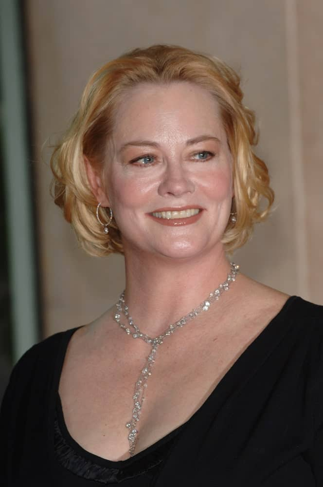 This tousled chin-length layered bob is all you need to rock this look, just like Cybill Shepherd. Notice how the layers of varying lengths and the combo of curls and curves work together to create the perfect lady-like look.