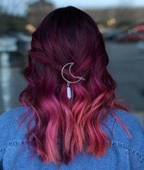 With out-of-this-world colors like plum, magenta, cherry pink and violet in this balayage, this woman's hair looks good enough to eat.