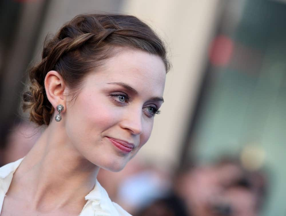 Emily Blunt's hair is one of the most coolest and versatile in the industry. Case in point: this very adorable hairstyle that starts off from a braid at the front and twists back into a messy bun. The look is youthful, classy and very pretty.