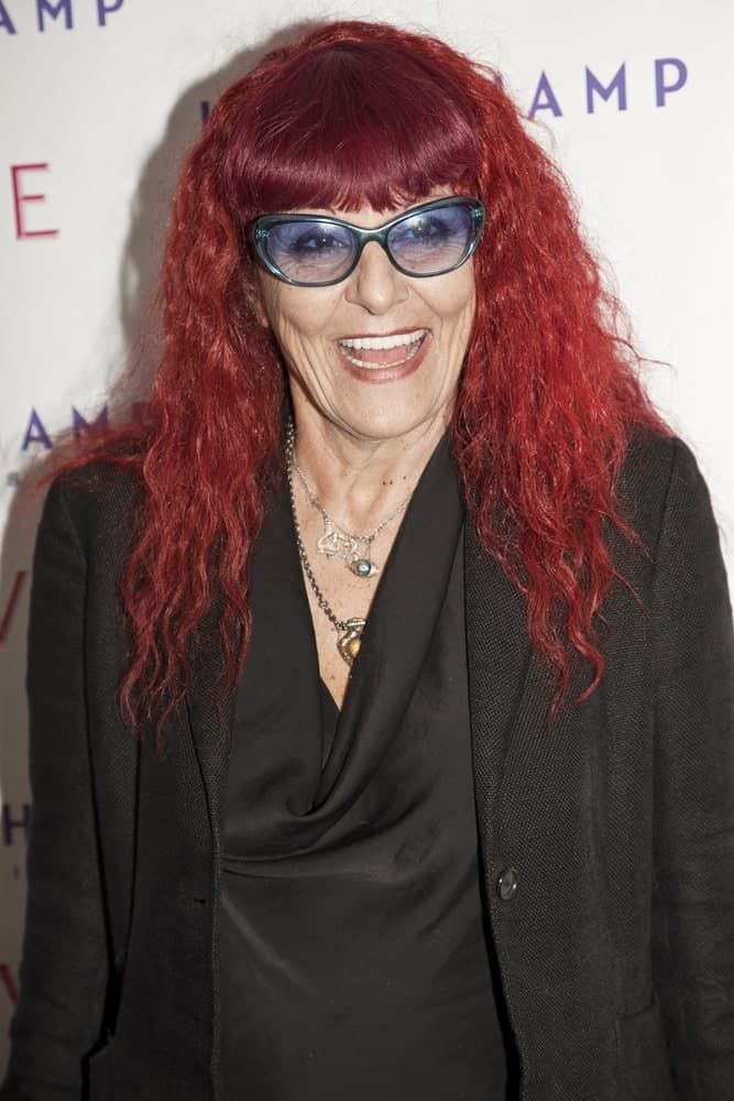Long red curly hair seems to be working well for Patricia Fields. The best part about this look is that the glasses and the hairstyle can be equally appreciated, both making a strong impact on the overall appearance. To complete the look, add heavy front fringes to the equation.