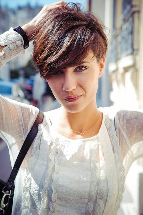 This style of pixie has choppy, unequal-sized hair, giving the cut more definition and volume. The pixie haircut on this young woman is a feathered dream.