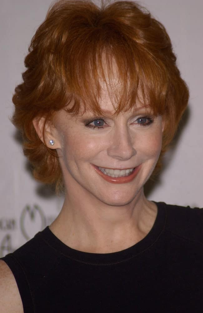 Opting for short hair does not mean lack of texture and style. Here we see Reba McEntire, the famous singer, portraying another example of short hair with extra volume, perfect texture, and outstanding style! The front layers are what made this haircut popular among not only those over 60 but women of all ages.