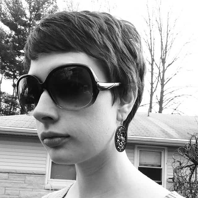 This pixie cut is super-short in the back and longer in the front, like a reverse mullet or tellum. This is a perfect compromise for those people who want to keep their hair off their nape but also want to frame their forehead.