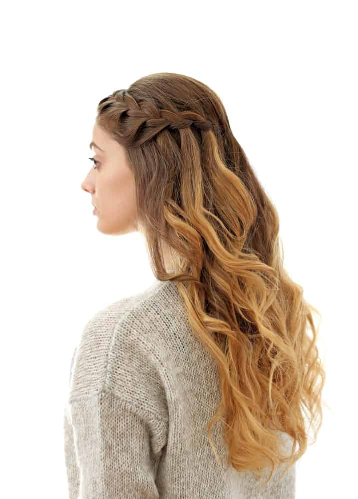 Side flowing waterfall braid is a beautiful option for longer hair. It's easy to do and is a very pretty, feminine finish to a hairdo. The best part is that it works for any hair length and looks just as good.