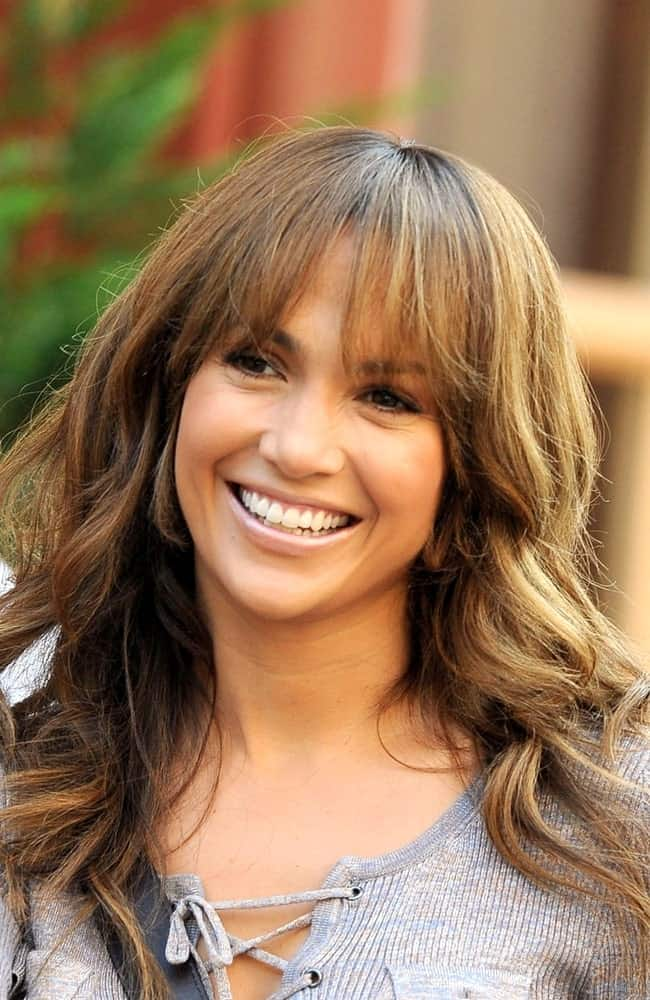Jennifer Lopez has one of the most versatile faces in the industry. The actress looks great in whatever she wears, hairstyle no exception. To copy the look, keep your front bangs light, airy and straight. Style your locks into long, flowing beachy waves.