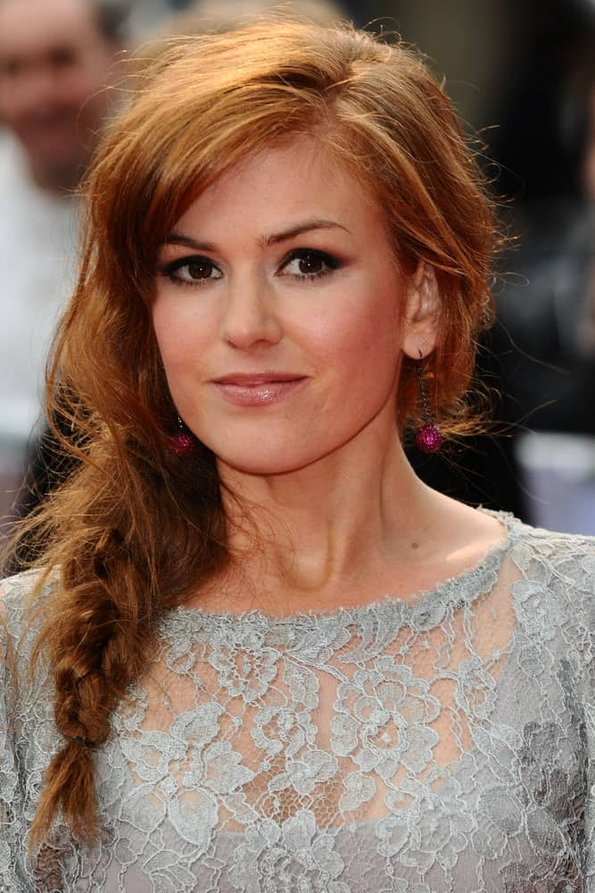 If very intricate braids are not your style, try a simpler fishtail braid for a more casual and effortless finish like Isla Fisher does here. Leaving a few strands loose gives the look a softer finish.