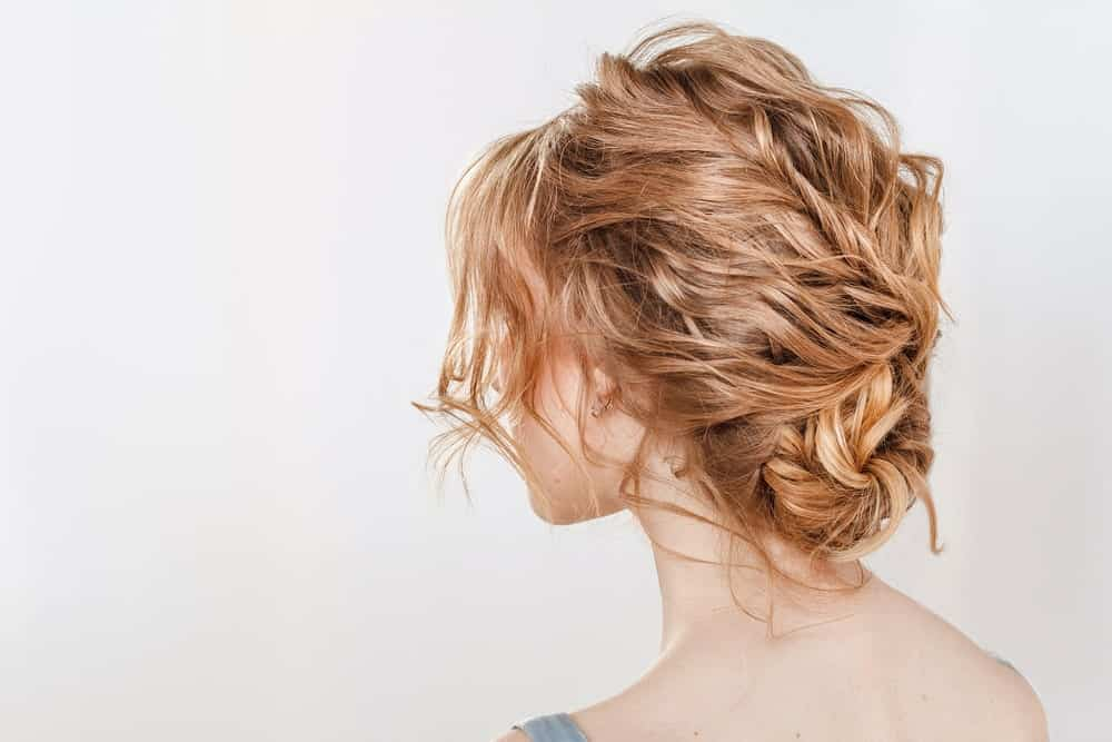If you want an updo but don't want braids, try this hairstyle. With messy waves and carefree bangs, it'll make you look effortlessly stylish while keeping your hair behaving through all that dancing.