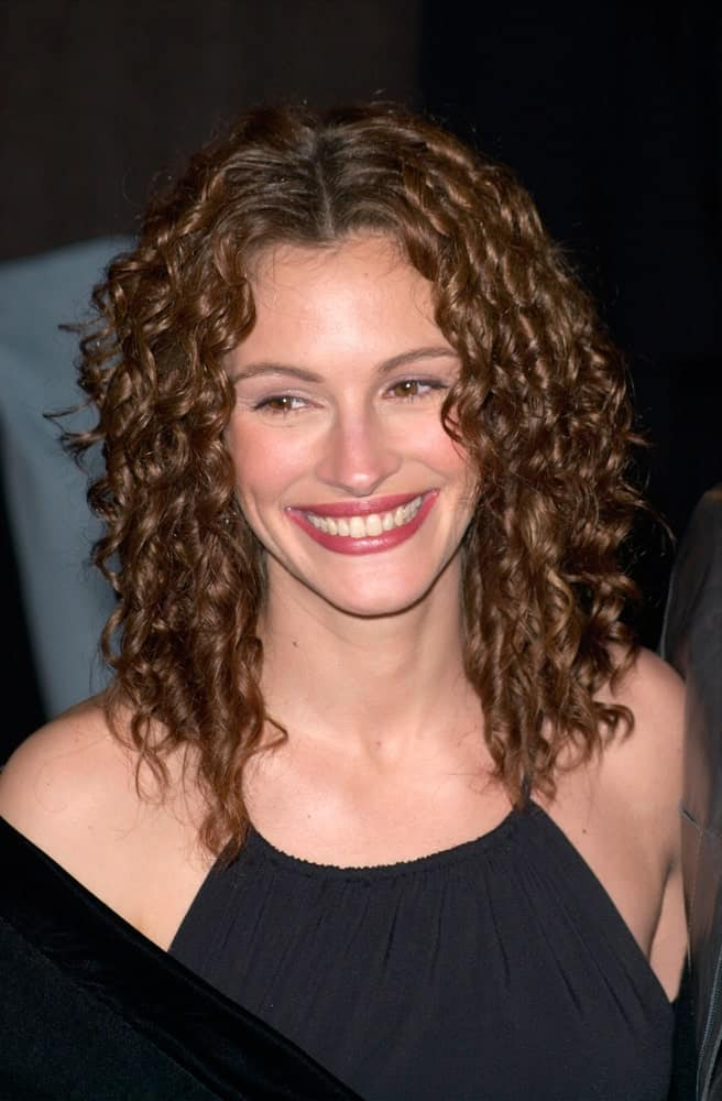 Julia Robert's dark copper locks look absolutely gorgeous with tight curls and a middle parting. It's a great hairdo that enhances the different shades in your hair color.
