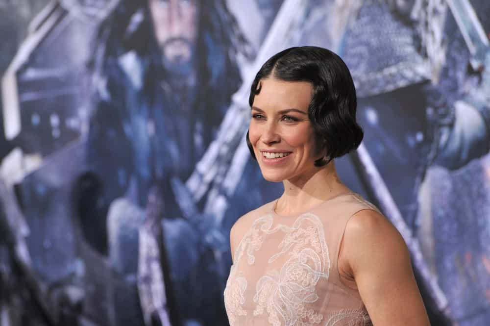 "She might be the star of ""The Hobbit"" but Evangeline Lilly's hairstyle is straight from ""The Great Gatsby."" The very 1920's hairstyle, worn by flappers, was given a super-dark brunette color that showed off the actress' green eyes."