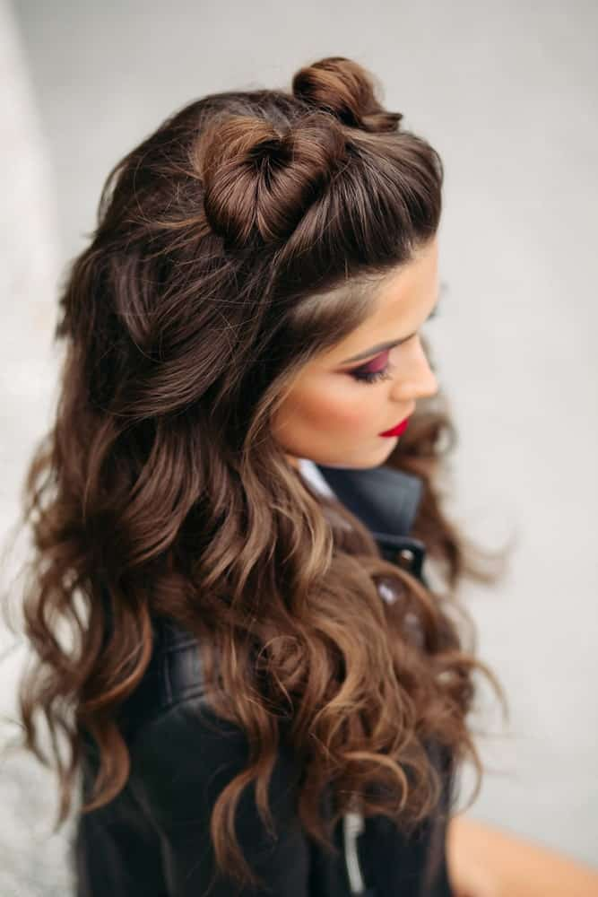 If you want to really stand out at prom, go for this hairdo with funky twisting top knots and cascading curls to accompany them.
