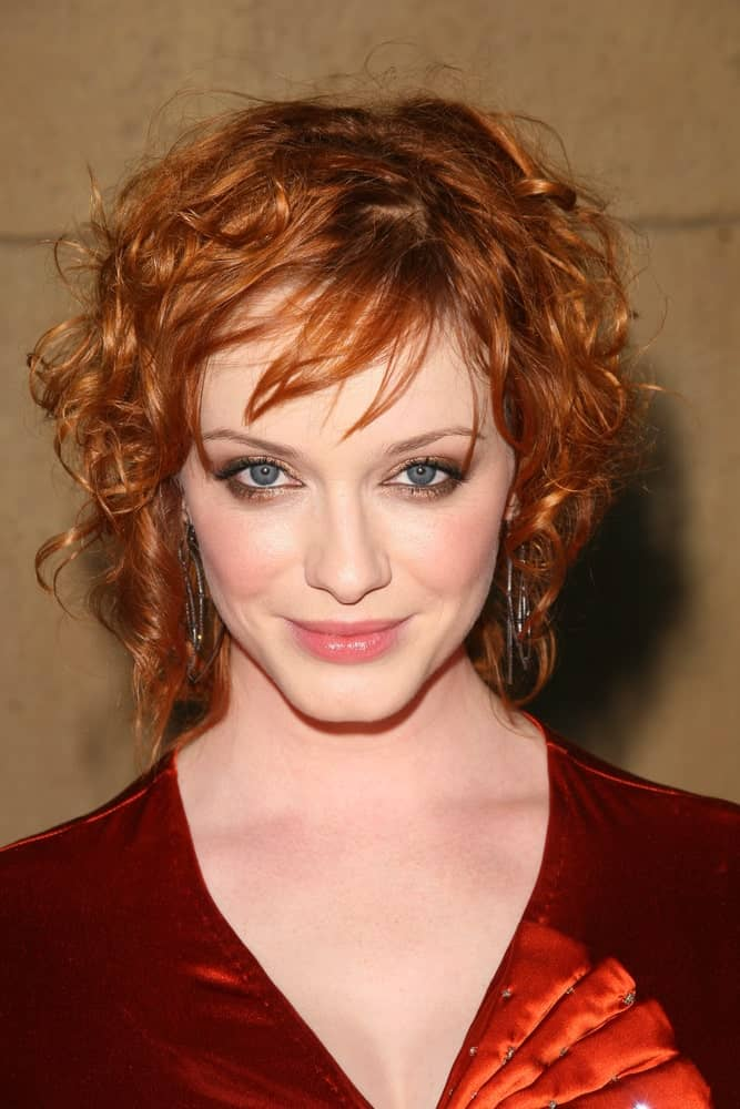 An angled bob for curly copper hair can give a very artistic, carefree look to any face shape!