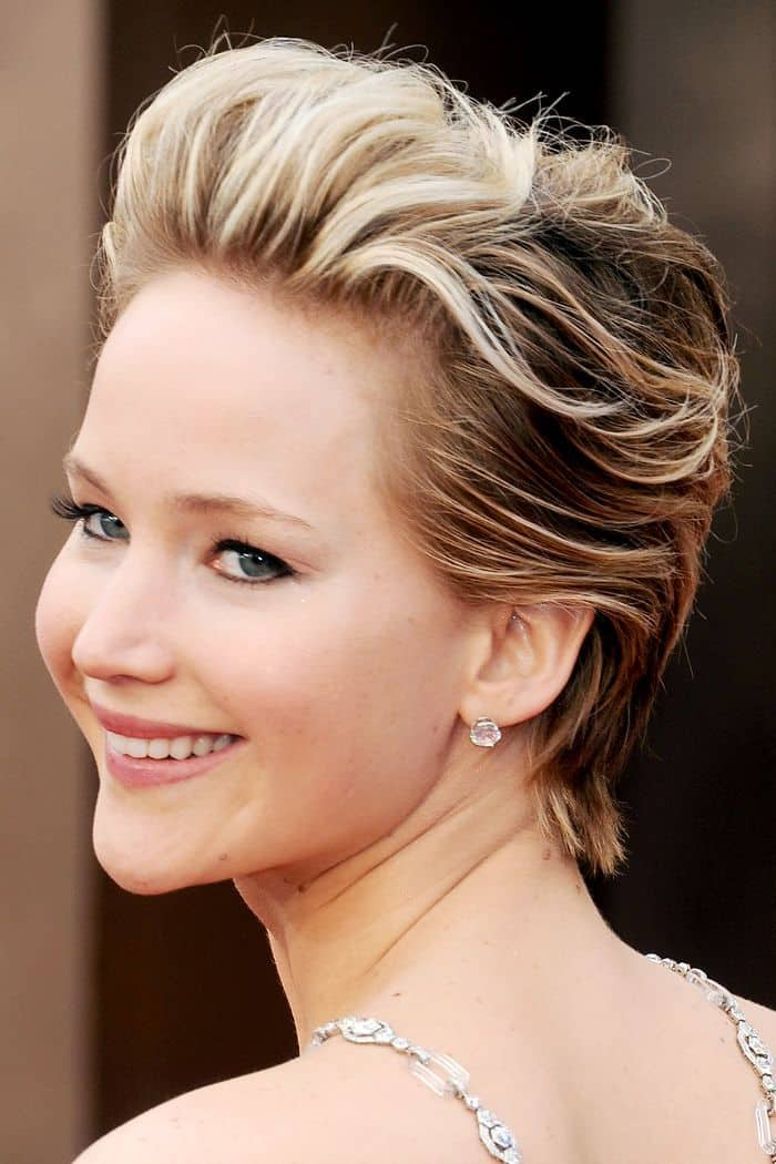 Jennifer Lawrence has tried a lot of pixie hairstyles but this one is one of her best. The actress has added some wave and highlight to the front of her hair and swept it back on top of her head. The sides and the back remain straight ad dark.