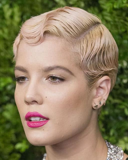 This immaculately crimped and slicked back pixie cut gives off a very '20s style vibe. This is a great style for people with straight and fine hair.