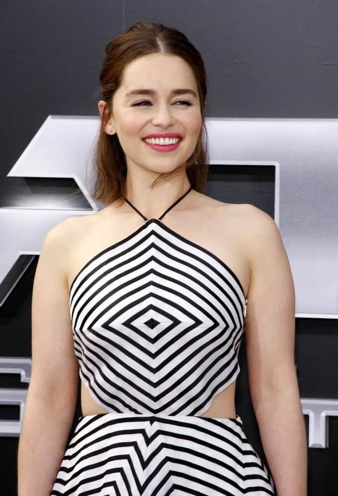 "When she isn't playing the silver-haired Daenerys Targaryen, Emilia Clarke actually lives out her life as a brunette. Unlike her elaborate hairstyle in ""Game of Thrones,"" the brown-haired beauty likes to keep things simple. Case in point: The actress chose to wear simple, no-fuss half updo for the premiere of ""Terminator Genisys."" The hairstyle is super cute and elegant."