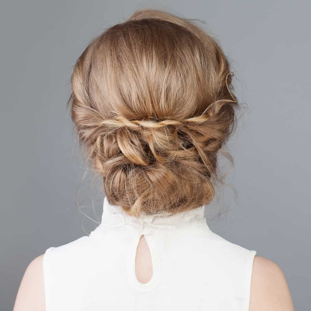 This hairstyle has a bun that incorporates some twists, braids, and some pinning. In other words, a bun that has all of our favorite things!
