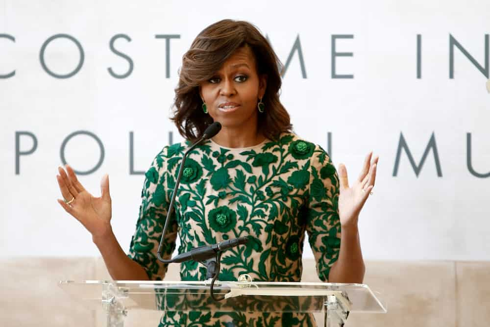 The ever-elegant former first lady shows you how to keep your bangs curled back and elegant. Get your stylist to give your hair some loose curls, like Michelle. Make a deep side part and curls the hair to the side with a curling comb.