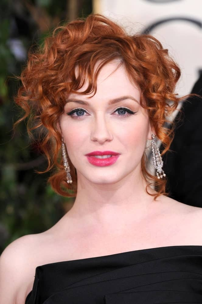 Who says messy curls can't look elegant? Christina Hendricks once again rocks her copper hair at the Golden Globe Awards and somehow manages to makes messy curls piled on top of her hair look extremely glamorous.