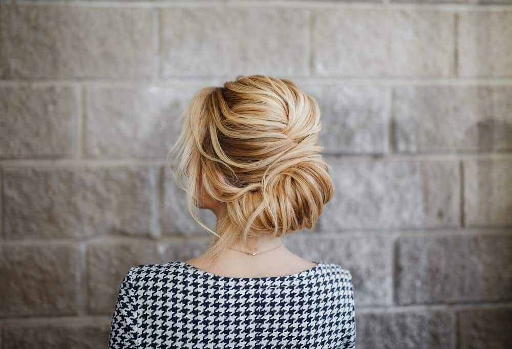 One of the most favored styles of updo, the French twist has not yet lost its appeal. What is so wonderful about it is that it has so many variants, from a regal sleek twist to a messy knot.