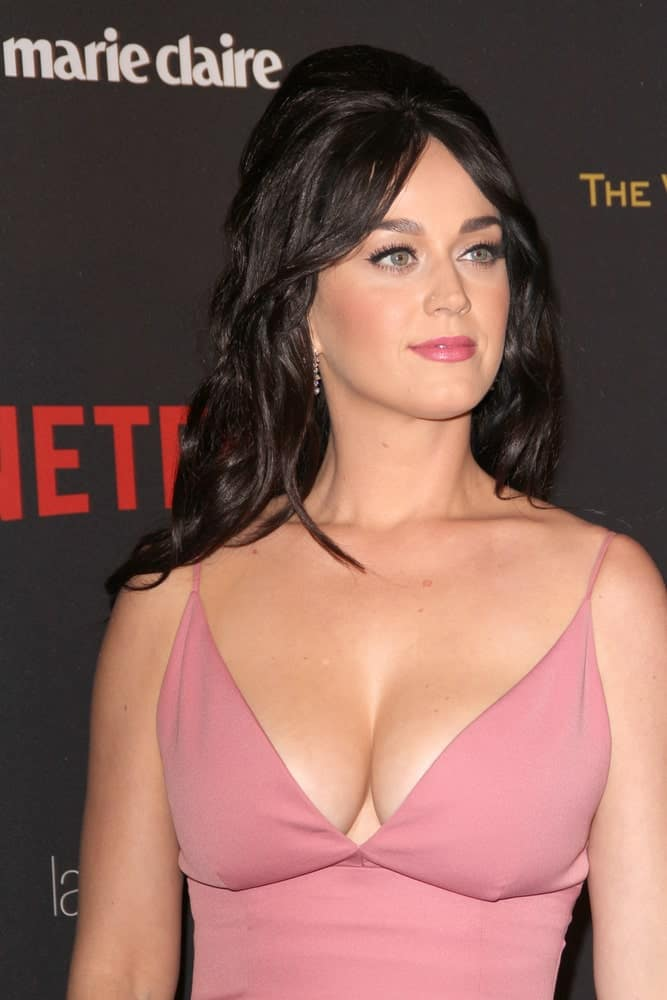 Katy Perry rocks a very Cleopatra inspired hairdo for the Golden Globes after party with heavy backcombing and twisting curls. She's left her bangs to frame her face giving the overall look a classy but soft finish.